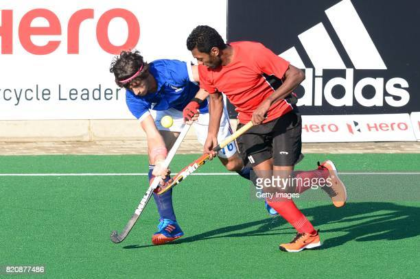 Francois Goyet of France tackled by Ahmed Elnaggar of Egypt during day 8 of the FIH Hockey World League Men's Semi Finals 7th8th place match between...
