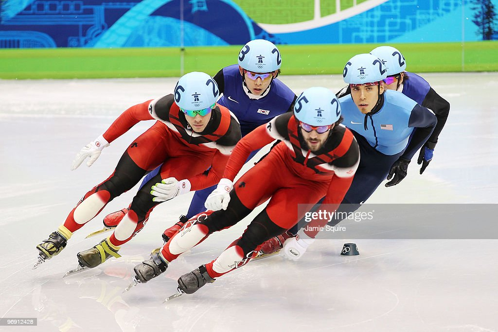 Francois Hamelin of Canada, Lee Jung-Su of South Korea, <a gi-track='captionPersonalityLinkClicked' href=/galleries/search?phrase=Charles+Hamelin&family=editorial&specificpeople=820316 ng-click='$event.stopPropagation()'>Charles Hamelin</a> of Canada, <a gi-track='captionPersonalityLinkClicked' href=/galleries/search?phrase=Apolo+Anton+Ohno&family=editorial&specificpeople=213110 ng-click='$event.stopPropagation()'>Apolo Anton Ohno</a> of the United States and Lee Ho-Suk of South Korea compete during the Short Track Speed Skating Men's 1000 m fiinal on day 9 of the Vancouver 2010 Winter Olympics at Pacific Coliseum on February 20, 2010 in Vancouver, Canada.