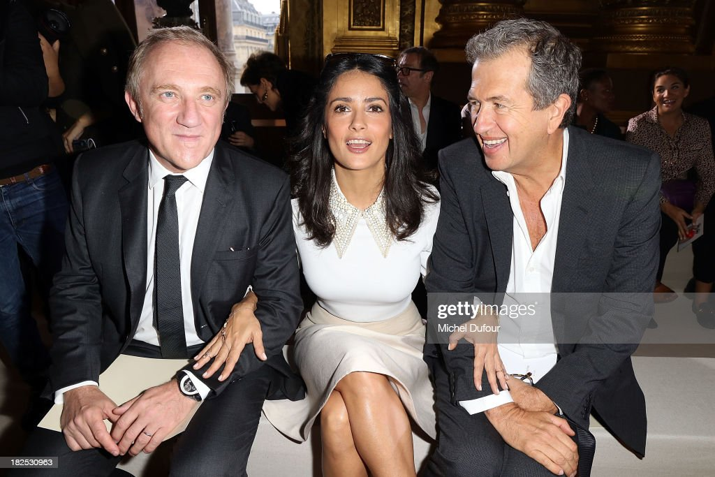 Francois Henri Pinault, <a gi-track='captionPersonalityLinkClicked' href=/galleries/search?phrase=Salma+Hayek&family=editorial&specificpeople=201844 ng-click='$event.stopPropagation()'>Salma Hayek</a> and <a gi-track='captionPersonalityLinkClicked' href=/galleries/search?phrase=Mario+Testino&family=editorial&specificpeople=203087 ng-click='$event.stopPropagation()'>Mario Testino</a> attend the Stella McCartney show as part of the Paris Fashion Week Womenswear Spring/Summer 2014 on September 30, 2013 in Paris, France.