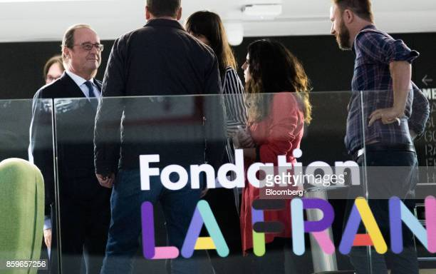 Francois Hollande France's former president left speaks to employees in the offices of nonprofit foundation 'La France sengage' meaning 'France...
