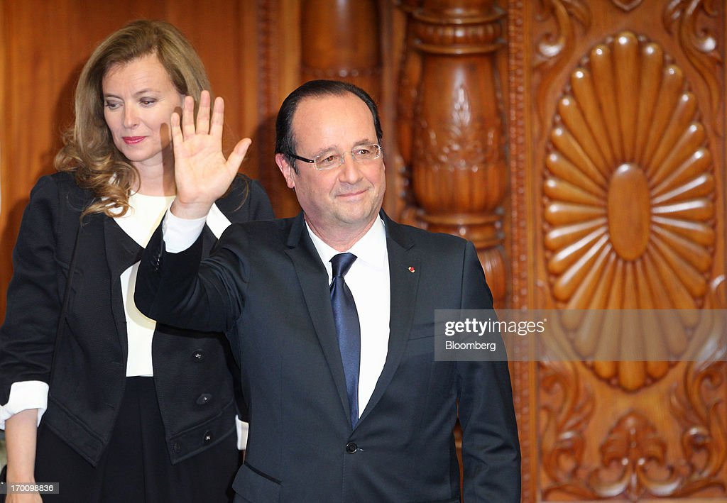 Francois Hollande, France's president, center, waves as he and <a gi-track='captionPersonalityLinkClicked' href=/galleries/search?phrase=Valerie+Trierweiler&family=editorial&specificpeople=8534231 ng-click='$event.stopPropagation()'>Valerie Trierweiler</a>, France's first lady, leave following Hollande's speech in the upper house of Parliament in Tokyo, Japan, on Friday, June 7, 2013. Japanese Prime Minister Shinzo Abe and Hollande agreed to deepen cooperation on nuclear reactor exports and to consider working together on defense equipment development. Photographer: Koichi Kamoshida/Bloomberg via Getty Images