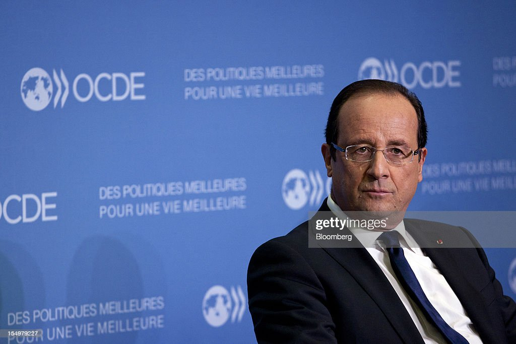 Francois Hollande, France's president, sits and listens during a news conference following a meeting hosted by the Organization for Economic Cooperation and Development (OECD) in Paris, France, on Monday, Oct. 29, 2012. Hollande said he wants the euro group of finance ministers to find a 'durable' solution to Greece's debt problems at their November meeting. Photographer: Balint Porneczi/Bloomberg via Getty Images