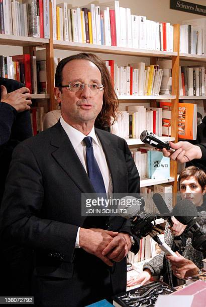 Francois Hollande France's Socialist Party candidate for the 2012 French presidential election speak to the media during his visit a the 'Comme un...