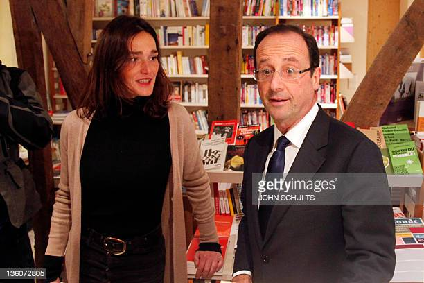 Francois Hollande France's Socialist Party candidate for the 2012 French presidential election reacts as he listens to Karine Henry one of the owners...