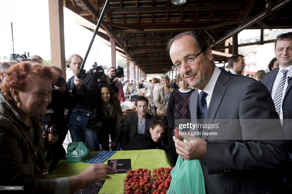Francois Hollande presidential candidate of the second round visit the market of Tulle with partner Valerie Trierweiler the eve of the vote on May 5...