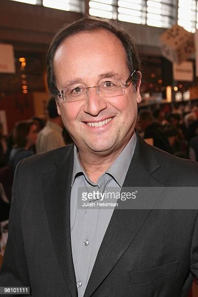 Francois Hollande signs copies of hir book 'Droit d'inventaires' at the 30th salon du livre at Porte de Versailles on March 28 2010 in Paris France