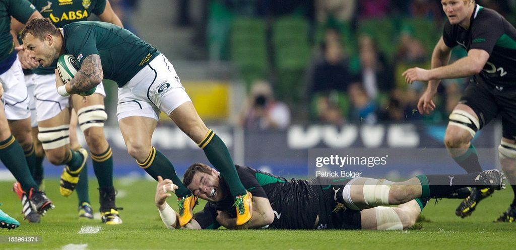 <a gi-track='captionPersonalityLinkClicked' href=/galleries/search?phrase=Francois+Hougaard&family=editorial&specificpeople=4229504 ng-click='$event.stopPropagation()'>Francois Hougaard</a> of South Africa and Peter O'Mahony of Ireland compete during the International rugby match between Ireland and South Africa in the Aviva Stadium on November 10, 2012 in Dublin, Ireland.