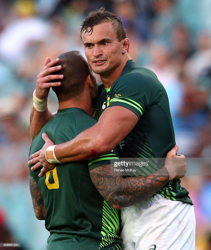 <a gi-track='captionPersonalityLinkClicked' href=/galleries/search?phrase=Francois+Hougaard&family=editorial&specificpeople=4229504 ng-click='$event.stopPropagation()'>Francois Hougaard</a> of South Africa and team mate Carel du Preez celebrate their win during the day 1 match between South Africa and Kenya at the HSBC Sydney Sevens at Allianz Stadium on February 06, 2016 in Sydney, Australia.