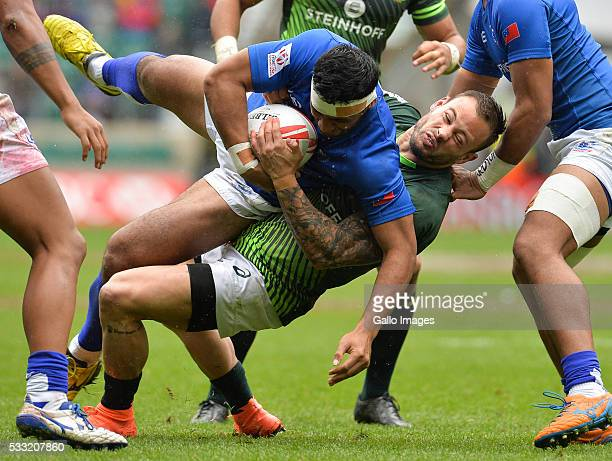 Francois Hougaard of South Africa tackles Alefosio Tapili of Samoa during the match between South Africa and Samoa on day 1 of the HSBC World Rugby...