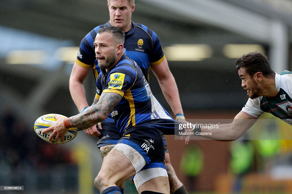 Francois Hougaard of Worcester Warriors is held back by Peter Betham of Leicester Tigers during the Aviva Premiership game between Leicester Tigers and Worcester Warriors at Welford Road on April 30, in Leicester, England.