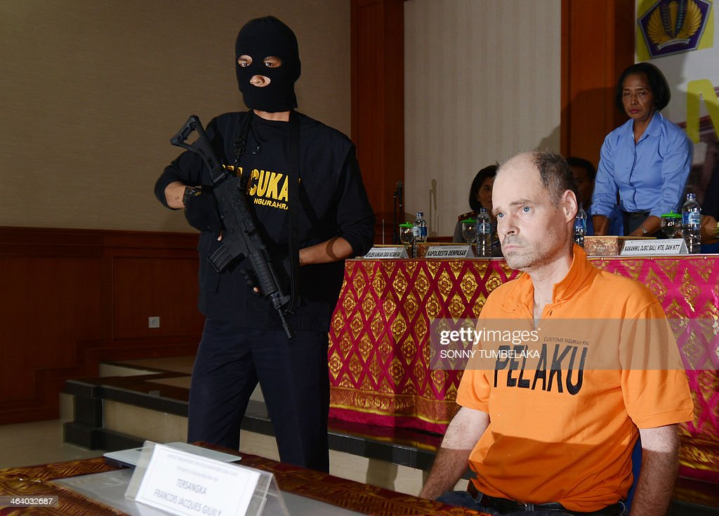Francois Jacques Giuily (R) of France sits inside the Custom office in Denpasar on January 20, 2014. Giuily was arrested on January 19 carrying 3.083 grams of methamphetamine in his luggage at Bali International Airport in Indonesia, officials said.