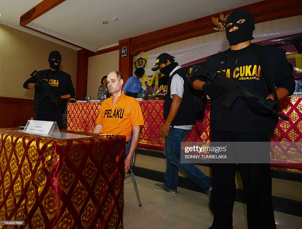 Francois Jacques Giuily (C) of France sits inside the Custom office in Denpasar on January 20, 2014. Giuily was arrested on January 19 carrying 3.083 grams of methamphetamine in his luggage at Bali International Airport in Indonesia, officials said.