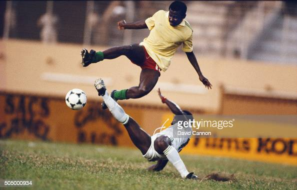 Francois Lea N'doumbe of Cameroon avoids a challenge from Pascal Miezen during the 1984 African Cup of Nations match between Cameroon and Ivory Coast...
