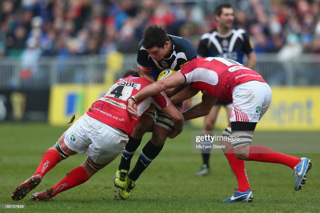 <a gi-track='captionPersonalityLinkClicked' href=/galleries/search?phrase=Francois+Louw&family=editorial&specificpeople=4389467 ng-click='$event.stopPropagation()'>Francois Louw</a> (C) of Bath is tackled by Jonathan MIlls (L) and Julio Cabello Farias (R) of London Welsh during the Aviva Premiership match between Bath and London Welsh at the Recreation Ground on March 30, 2013 in Bath, England.