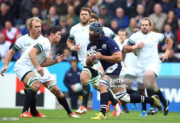 Francois Louw of South Africa looks to tackle Josh Strauss of Scotland during the Rugby World Cup 2015 Pool B match between South Africa and Scotland...