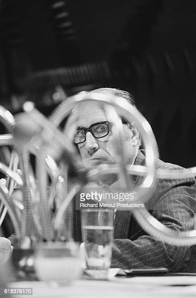 Francois Mitterrand leader of the French Socialist Party peers through cables while broadcasting at RTL radio station in Paris Mitterrand served as...