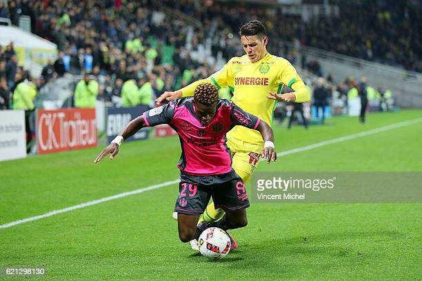 Francois Moubandje of Toulouse and Mariusz Stepinski of Nantes during the Ligue 1 match between Fc Nantes and Toulouse Fc at Stade de la Beaujoire on...