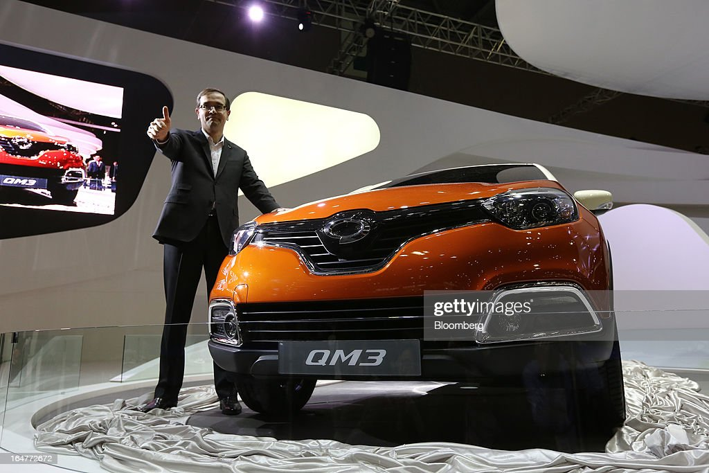 Francois Provost, chief executive officer of Renault Samsung Motors Co., poses for a photograph next to the company's QM3 vehicle during the press day of the Seoul Motor Show in Goyang, South Korea, on Thursday, March 28, 2013. The show runs from today until April 7. Photographer: SeongJoon Cho/Bloomberg via Getty Images