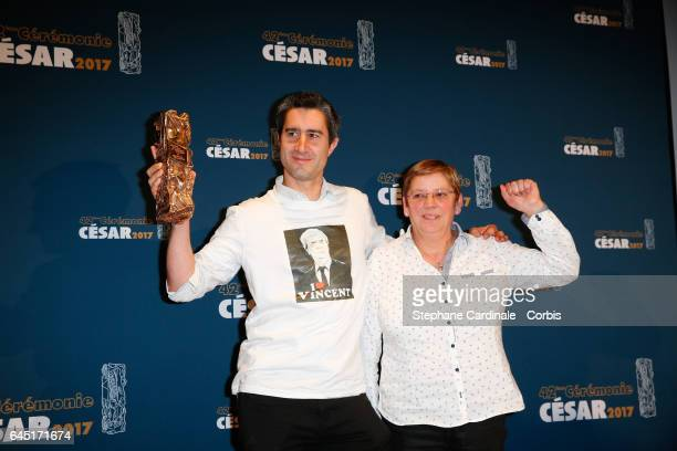 Francois Ruffin and a guest pose with his award at the Cesar Film Awards 2017 at Salle Pleyel on February 24 2017 in Paris France
