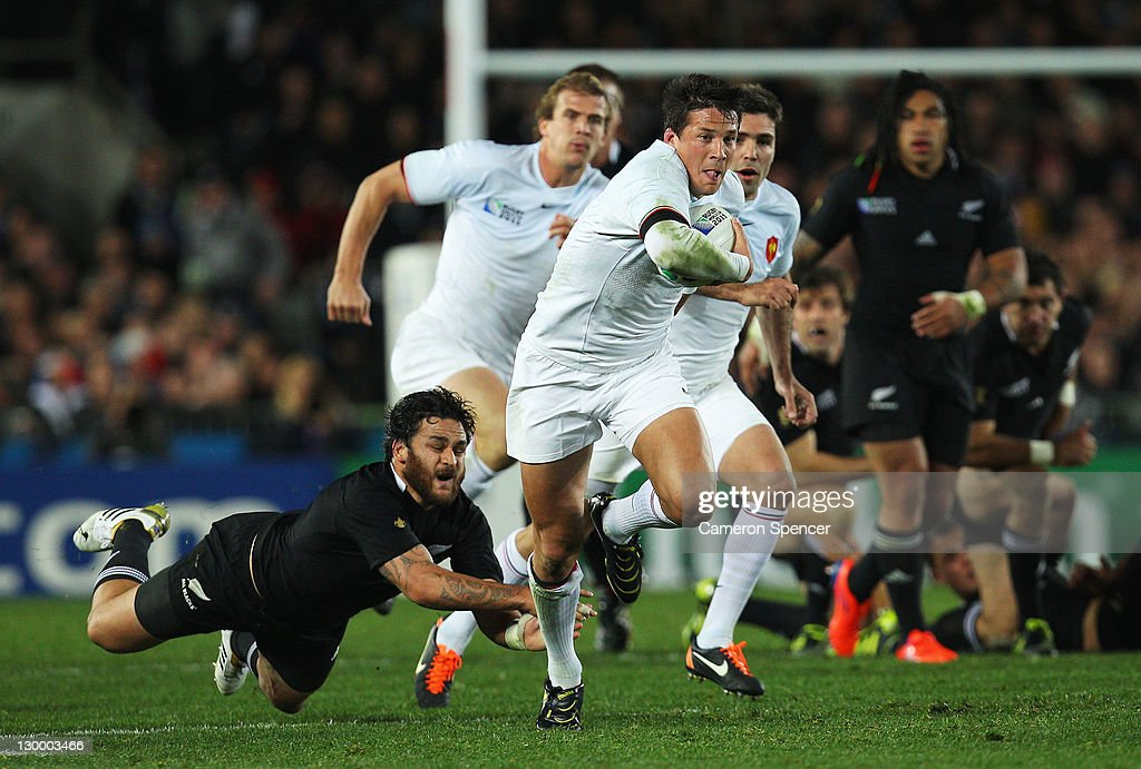 Francois Trinh-Duc of France evades a tackle by Piri Weepu of the All Blacks during the 2011 IRB Rugby World Cup Final match between France and New Zealand at Eden Park on October 23, 2011 in Auckland, New Zealand.
