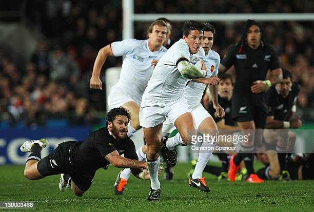 Francois TrinhDuc of France evades a tackle by Piri Weepu of the All Blacks during the 2011 IRB Rugby World Cup Final match between France and New...