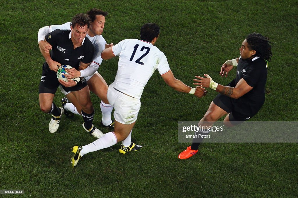 Francois Trinh-Duc of France tackles <a gi-track='captionPersonalityLinkClicked' href=/galleries/search?phrase=Aaron+Cruden&family=editorial&specificpeople=5501441 ng-click='$event.stopPropagation()'>Aaron Cruden</a> of the All Blacks during the 2011 IRB Rugby World Cup Final match between France and New Zealand at Eden Park on October 23, 2011 in Auckland, New Zealand.