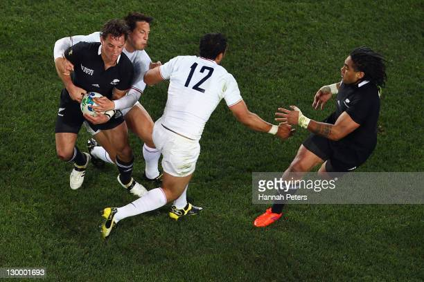 Francois TrinhDuc of France tackles Aaron Cruden of the All Blacks during the 2011 IRB Rugby World Cup Final match between France and New Zealand at...