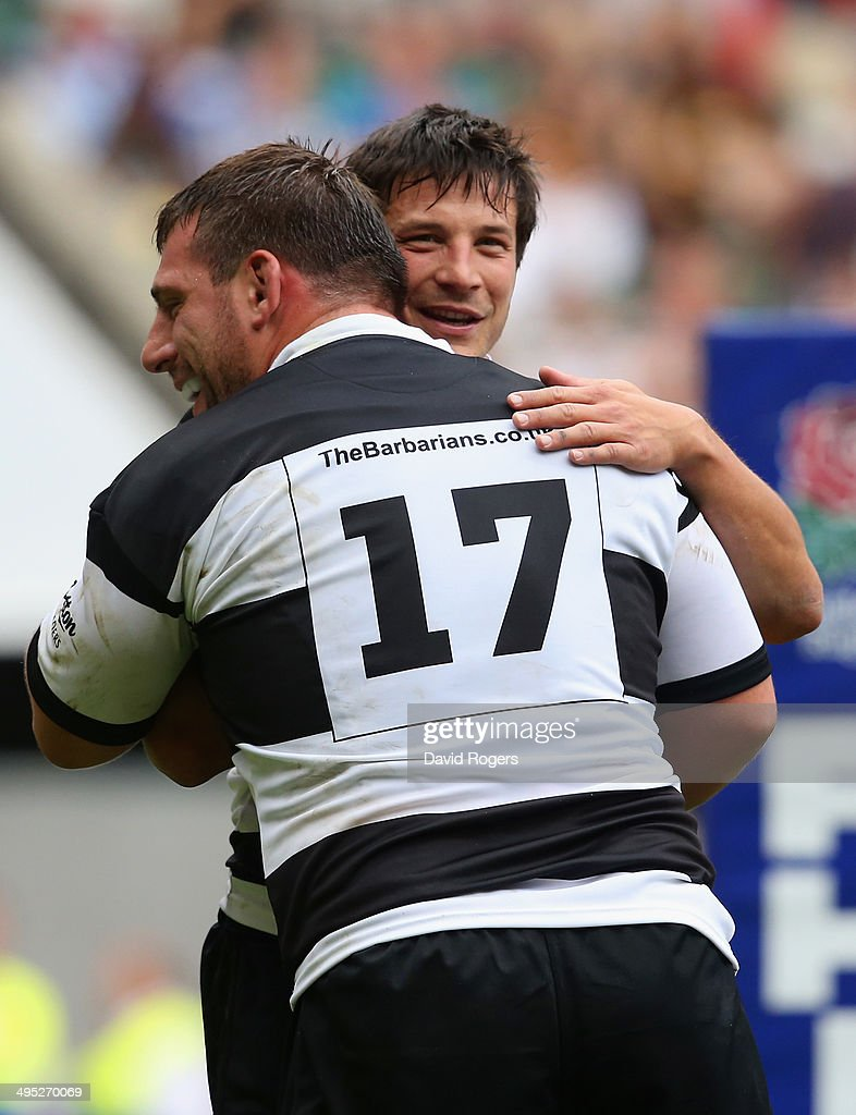 Francois Trinh-Duc of the Barbarians hugs Julien Brugnaut of the Barbarians during the Rugby Union International Match between England and The Barbarians at Twickenham Stadium on June 1, 2014 in London, England.