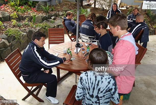 Francois TrinhDuc of the French IRB Rugby World Cup 2011 squad signs autographs during a traditional Kiwi BBQ on their day off at the Riverhead...