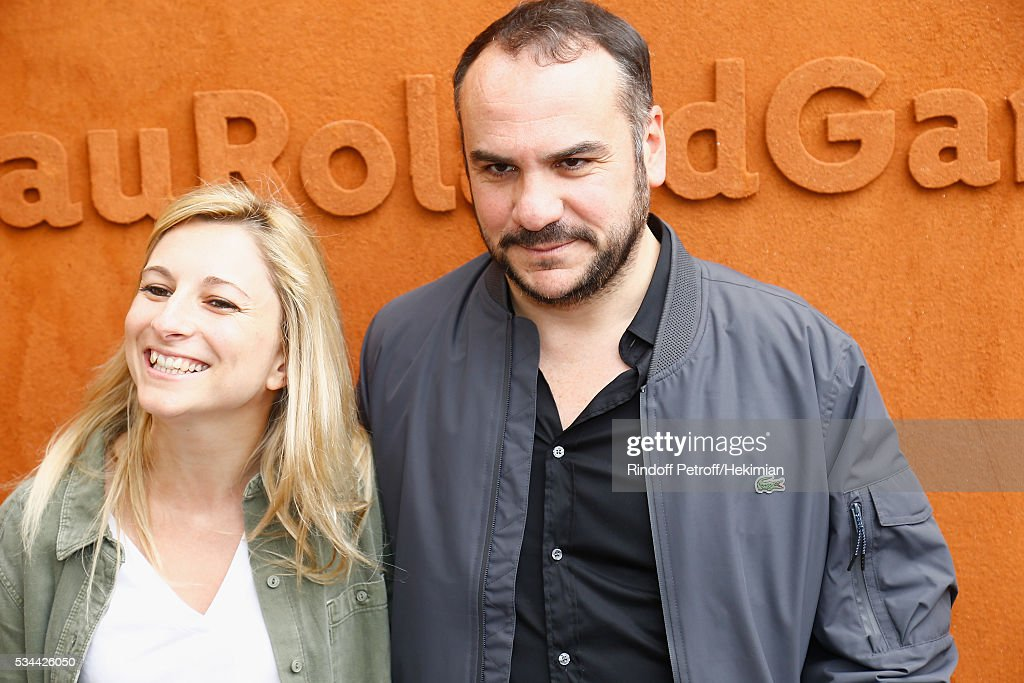 Francois Xavier Demaison and his companion Anais attend the French Tennis Open Day Five at Roland Garros on May 26, 2016 in Paris, France.