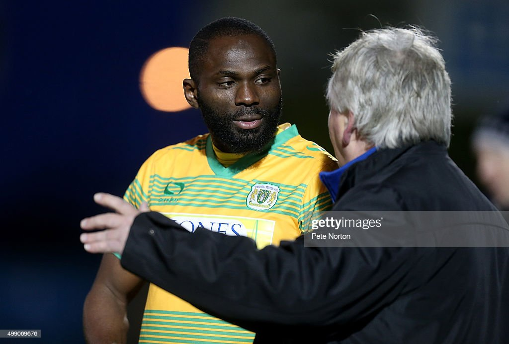 Francois Zoko of Yeovil Town is spoken to by manager Paul Sturrock prior to coming on as a substitute during the Sky Bet League Two match between...
