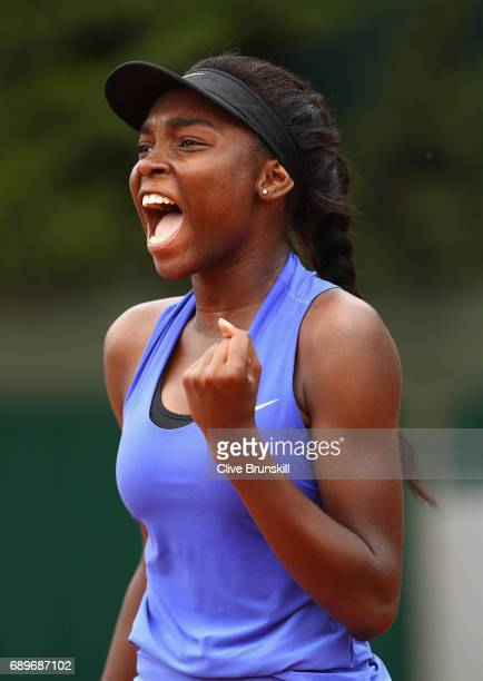 Francoise Abanda of Canada celebrates during the ladies singles first round match against Tessah Andrianjafitrimo of France on day two of the 2017...