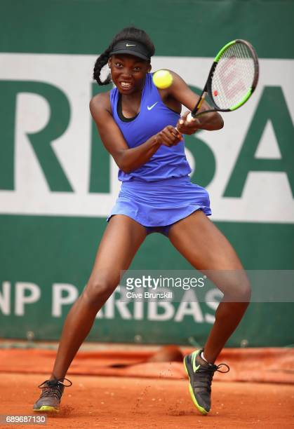 Francoise Abanda of Canada plays a backhand during the ladies singles first round match against Tessah Andrianjafitrimo of France on day two of the...