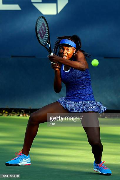 Francoise Abanda of Canada returns a shot against Sabine Lisicki of Germany during her women's singles first round match on Day One of the 2014 US...