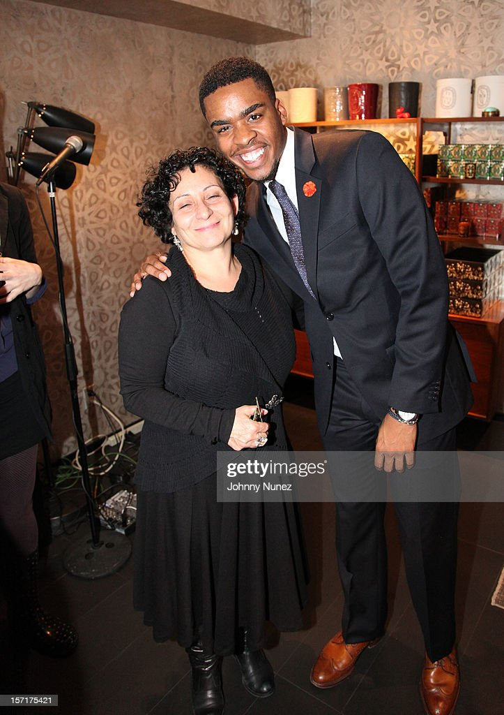 Francoise Alessi and Isaish Joyner attend the Reserv Concierge & Diptyque holiday shopping party at the Diptyque Store on November 29, 2012 in New York City.