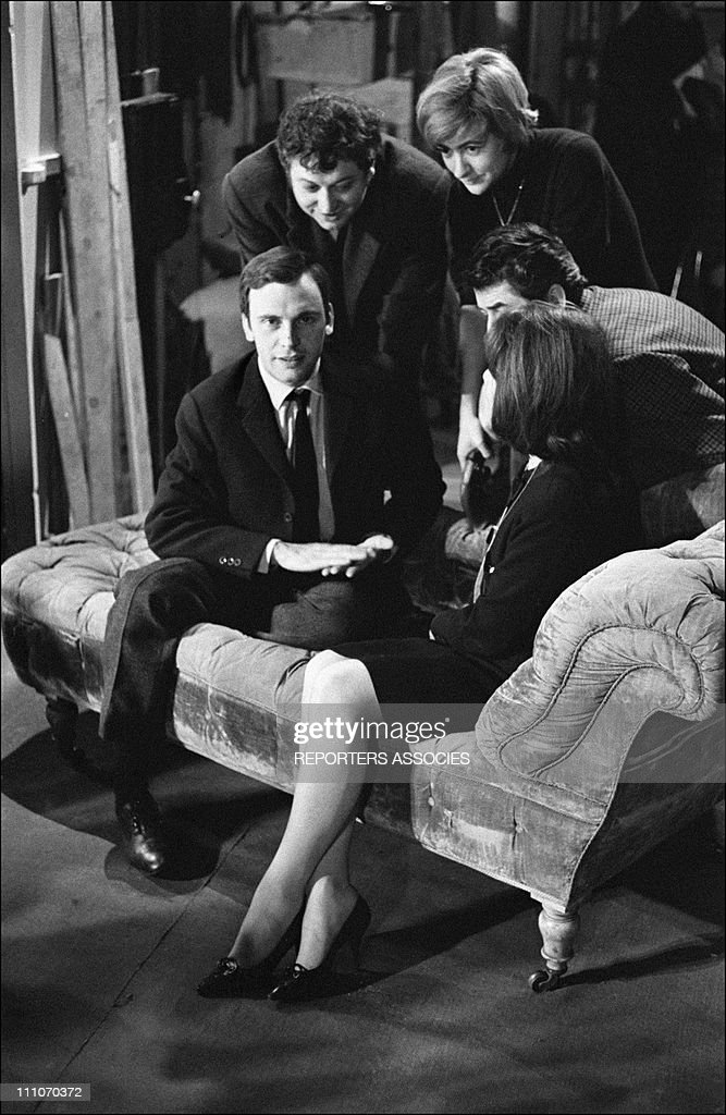 Francoise Sagan JeanLouis Trintignant Daniel Gelin and Juliette Greco at the Edourd VII theater in Paris France on December 30 1964