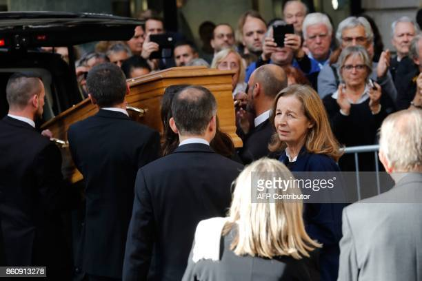 Francoise Vidal follows her husband French actor Jean Rochefort's coffin after his funeral at the SaintThomas d'Aquin church on October 13 2017 in...