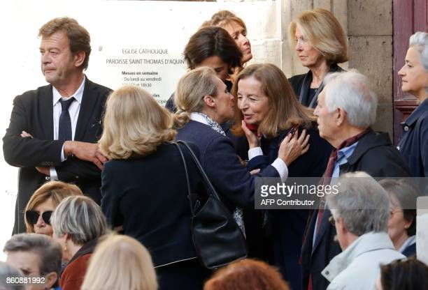 Francoise Vidal greets attendees before the funeral of her husband French actor Jean Rochefort at the SaintThomas d'Aquin church on October 13 2017...