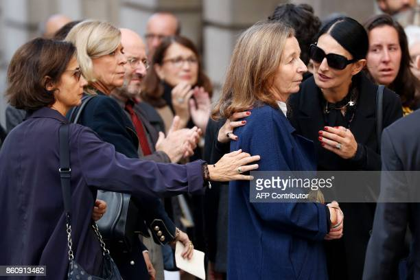 Francoise Vidal the widow of French actor Jean Rochefort is comforted by attendees as she leaves her husband's funeral at the SaintThomas d'Aquin...