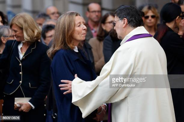 Francoise Vidal the widow of French actor Jean Rochefort talks with the priest after she leaves her husband's funeral at the SaintThomas d'Aquin...