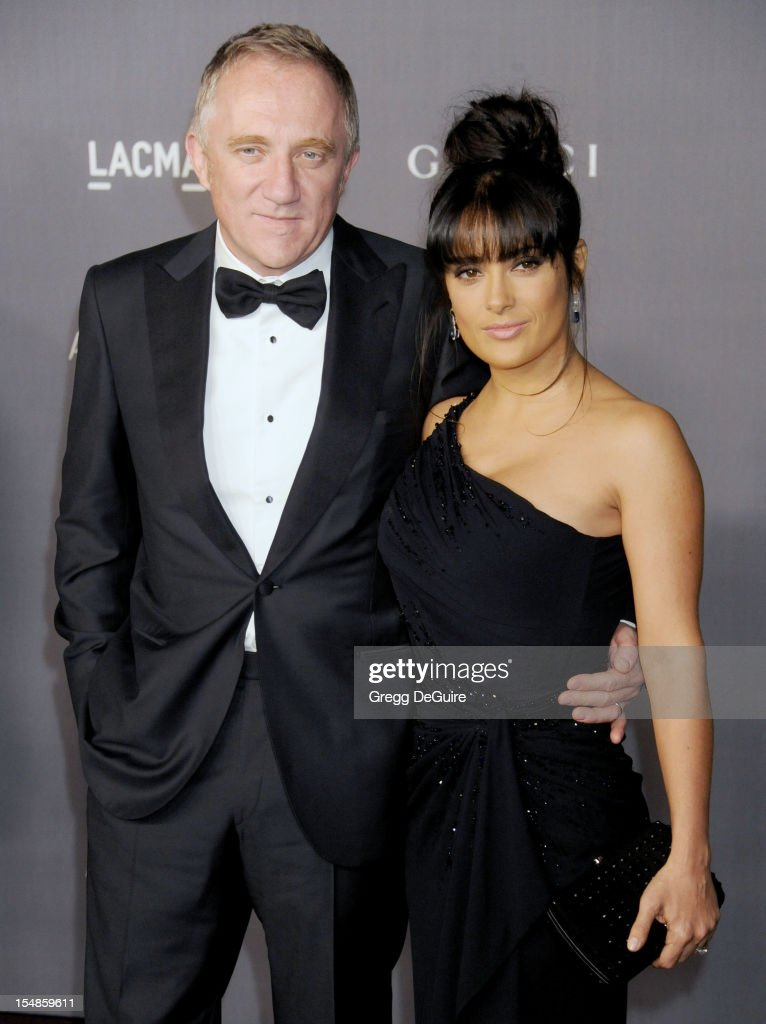 Francois-Henri Pinault and actress <a gi-track='captionPersonalityLinkClicked' href=/galleries/search?phrase=Salma+Hayek&family=editorial&specificpeople=201844 ng-click='$event.stopPropagation()'>Salma Hayek</a> arrive at LACMA Art + Gala at LACMA on October 27, 2012 in Los Angeles, California.