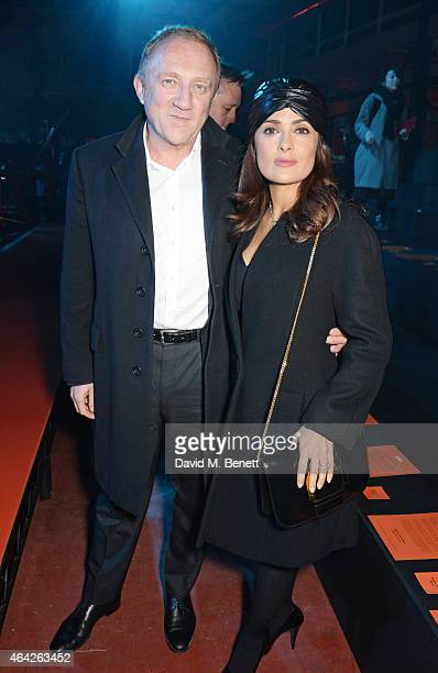 FrancoisHenri Pinault and Salma Hayek attend the Hunter Original AW15 catwalk show during London Fashion Week Autumn/Winter 2015/16 on February 23...