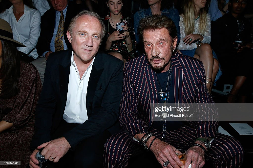 Francois-Henri Pinault and Singer Johnny Hallyday attend the Saint Laurent Menswear Spring/Summer 2016 show as part of Paris Fashion Week on June 28, 2015 in Paris, France.