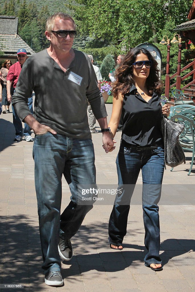 Francois-Henri Pinault (L), CEO of PPR, and his wife actress Salma Hayek attend the Allen & Company Sun Valley Conference on July 6, 2011 in Sun Valley, Idaho. The conference has been hosted annually by the investment firm Allen & Company each July since 1983. The conference is typically attended by many of the world's most powerful media executives.