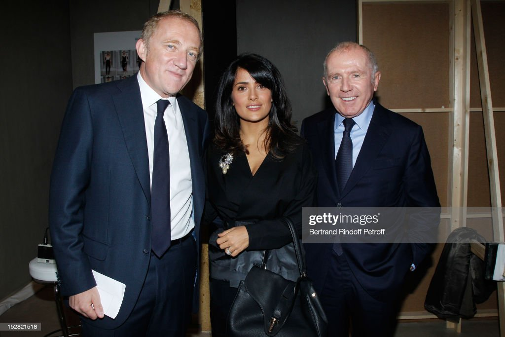 <a gi-track='captionPersonalityLinkClicked' href=/galleries/search?phrase=Francois-Henri+Pinault&family=editorial&specificpeople=532174 ng-click='$event.stopPropagation()'>Francois-Henri Pinault</a>, PPR CEO, his wife <a gi-track='captionPersonalityLinkClicked' href=/galleries/search?phrase=Salma+Hayek&family=editorial&specificpeople=201844 ng-click='$event.stopPropagation()'>Salma Hayek</a> and Francois Pinault, PPR Honorary President, attend the Balenciaga Spring / Summer 2013 show as part of Paris Fashion Week on September 27, 2012 in Paris, France.