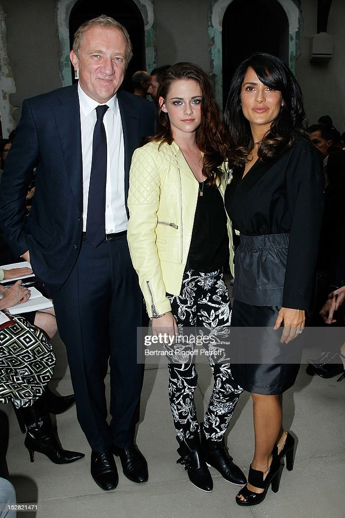 <a gi-track='captionPersonalityLinkClicked' href=/galleries/search?phrase=Francois-Henri+Pinault&family=editorial&specificpeople=532174 ng-click='$event.stopPropagation()'>Francois-Henri Pinault</a>, PPR CEO, <a gi-track='captionPersonalityLinkClicked' href=/galleries/search?phrase=Kristen+Stewart&family=editorial&specificpeople=2166264 ng-click='$event.stopPropagation()'>Kristen Stewart</a> and <a gi-track='captionPersonalityLinkClicked' href=/galleries/search?phrase=Salma+Hayek&family=editorial&specificpeople=201844 ng-click='$event.stopPropagation()'>Salma Hayek</a> attend the Balenciaga Spring / Summer 2013 show as part of Paris Fashion Week on September 27, 2012 in Paris, France.