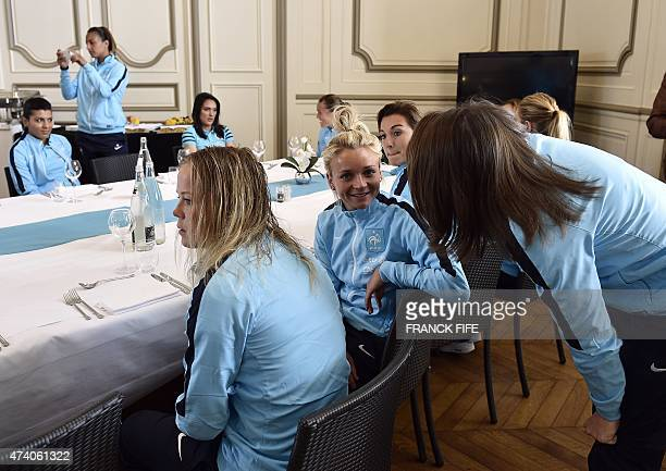 Frane's midfielder Marion Torrent chats before lunch at the French national football team training base in ClairefontaineenYvelines on May 11 2015 as...