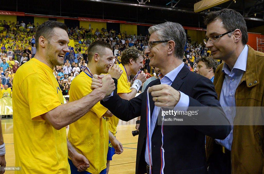 Franjo Bobinac president of the Handball federation of Slovenia presenting a gold medal to Luka Zvizej Team Celje won the National Cup for the 18th...
