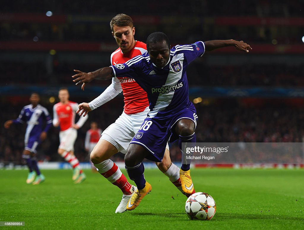 Frank Acheampong of Anderlecht holds off Aaron Ramsey of Arsenal during the UEFA Champions League Group D match between Arsenal FC and RSC Anderlecht...