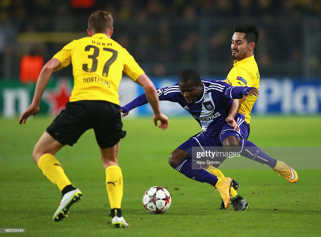 Frank Acheampong of Anderlecht is tackled by Ilkay Guendogan of Borussia Dortmund during the UEFA Champions League Group D match between Borussia...